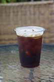 Sparkling Nitro Cold Brew Coffee. On table outdoor cafe ready to drink Stock Photo
