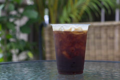 Sparkling Nitro Cold Brew Coffee. On table outdoor cafe ready to drink Stock Photos
