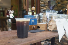 Sparkling Nitro Cold Brew Coffee. On wood table outdoor coffee cafe Stock Photos
