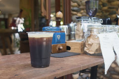 Sparkling Nitro Cold Brew Coffee. On wood table outdoor coffee cafe Stock Images