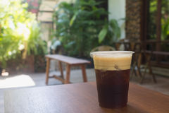 Sparkling Nitro Cold Brew Coffee on wooden table outdoor cafe. Ready to drink Stock Images