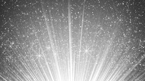 Sparkling particles in white light rays Stock Photos