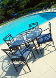 Sparkling Pool Metal Furniture. Relaxing pool scene at a high end resort Stock Images