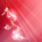 Sparkling red background with a stylized Christmas tree Stock Photography