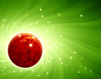Sparkling red disco ball on green light burst Royalty Free Stock Photography