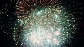 Night in color. Sparkling red firework fireworks ideal for parties, celebrations, new year or as a background stock image
