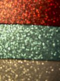 Sparkling red, green and silver background with sparkles and bok. Magical red, green and silver background with sparkles and bokeh Stock Photography