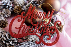Sparkling red merry christmas on handmade wreath Royalty Free Stock Image