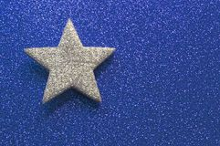 Sparkling silver star in brilliant golden background Stock Photography