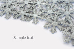 Sparkling snowflakes background. Sparkling snowflakes and place for sample text Royalty Free Stock Photo
