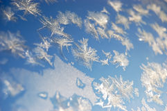 Sparkling snowflakes on a window Stock Photography
