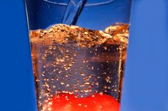 Sparkling Soda. Bubble from a soda pour into a glass Royalty Free Stock Image