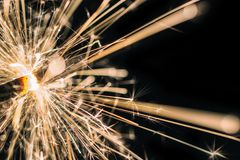 Sparkling sparkler in front of black background royalty free stock photos