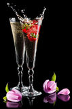 Sparkling splashing wine and roses Stock Photos