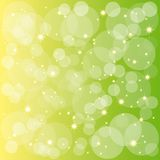 Sparkling stars bubbles on green yellow background Royalty Free Stock Photography
