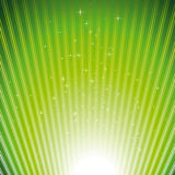 Sparkling stars on green light burst background Stock Photo