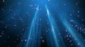 Sparkling stars in the rays of light (loop) stock video footage