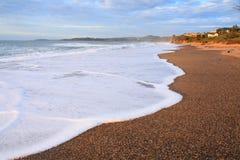 Sparkling Surf At Seashore Landscape By Sunrise Stock Images
