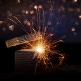 Sparkling surprise gift box. With festive bokeh background for christmas Stock Photography