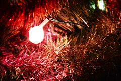 Sparkling tinsel and illuminated background Stock Images