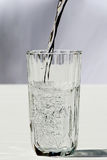 Sparkling water. Pouring sparkling water in a glass royalty free stock photography