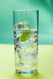 Sparkling water. Glass of sparkling water glass with ice cubes stock images