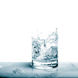 Sparkling water in broken glass. Fresh cold drink Stock Image