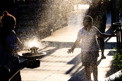 Sparkling water. Children playing with water in New York City Royalty Free Stock Photography