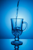 Sparkling water. Dynamic spike, thirst quenching on a hot day. Royalty Free Stock Photo