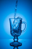 Sparkling water. Dynamic spike, thirst quenching on a hot day. Stock Photos