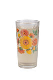Sparkling water in a glass with floral pattern isolated on a whi. Te background Royalty Free Stock Photo