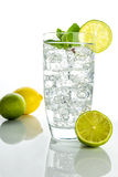 Sparkling water with ice cubes on white background Stock Images