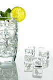 Sparkling water with ice cubes on white background Stock Photo