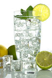 Sparkling water with ice cubes on white background Stock Photos