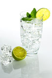 Sparkling water with ice cubes on white background Royalty Free Stock Image