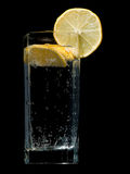 Sparkling water with lemon slice Stock Photos