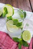Sparkling Water with Limes and Mint Royalty Free Stock Photos