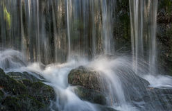 Sparkling water on small waterfall Royalty Free Stock Image