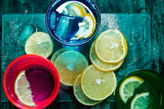 Sparkling water, soda or a gin and tonic in colorful glasses with lemon and ice Stock Image