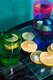 Sparkling water, soda or a gin and tonic in colorful glasses with lemon and ice. Royalty Free Stock Photo