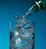 Sparkling Water Splashing On Ice Royalty Free Stock Photo