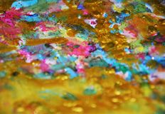 Blurred sparkling waxy vivid pastel spots watercolor blurred waxy gold spots colorful hues, strokes of brush, backgrounnd. Sparkling waxy pastel spots watercolor Royalty Free Stock Image