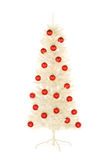 Sparkling white artificial Christmas tree decorated with red balls isolate Stock Photography