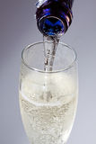 Sparkling wine. Gets pouring in a glass Stock Images