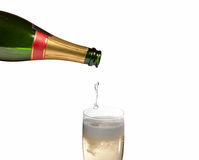 Sparkling wine. Being poured into a class Stock Images