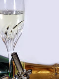 Sparkling wine. A bottle and a glass of sparkling wine with an opener Royalty Free Stock Photo