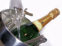 Sparkling wine. A bottle and a glass of sparkling wine with an opener Royalty Free Stock Photos