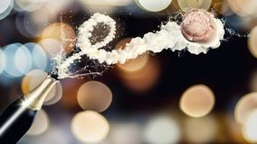 Sparkling wine bottle with flying cork. A champagne bottle with its cork flying away in a swirl of splashing champagne. Colorful bokeh background Stock Photos