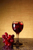 Sparkling wine and bunch grapes Royalty Free Stock Photo