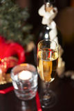 Sparkling wine and candle Royalty Free Stock Photos